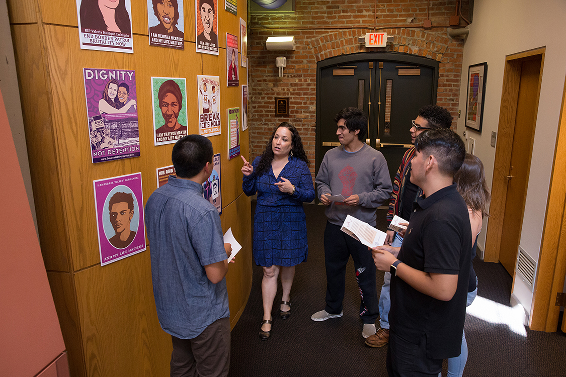Ella Diaz with students at Latina/o Studies Program at Cornell University and on site of installation of downloadable posters by Dignidad Rebelde